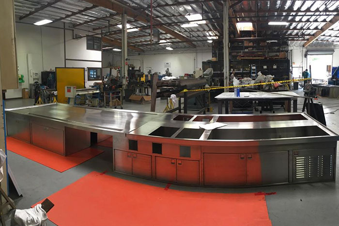 a galley made of sheet metal sitting in the Miller Marine factory